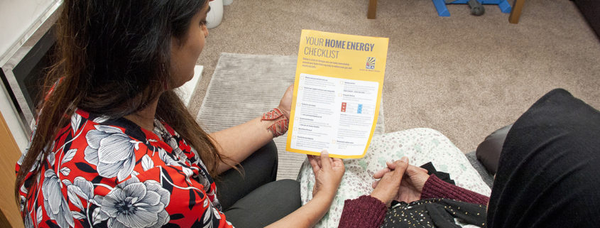NEA staff read leaflet to homeowner